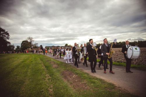 bride-groom-band-guests